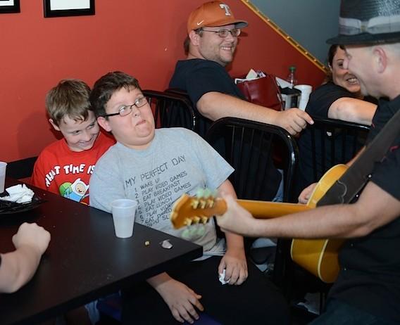 "Brad Birkedahl ""serenades""  a few Elvis fans during Elvis Week (August 2013)"