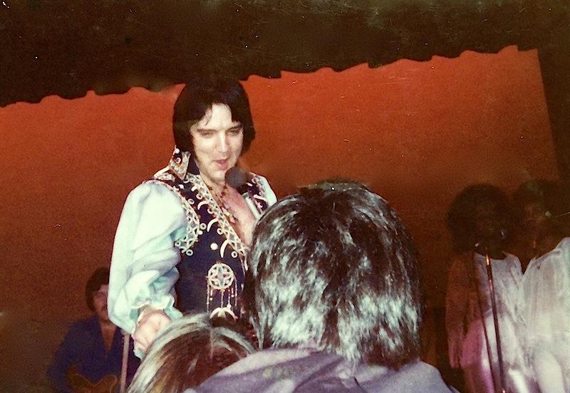 Elvis sings to fan Dee Dandken seated in the front row. 1970's Lake Tahoe, Nevada (Photo courtesy of Dee Dandken)
