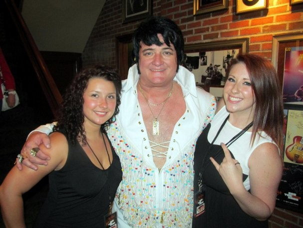 Jeff Lewis of Nashville, winner of the Hard Rock Cafe Memphis' Last Chance Ultimate Elvis Tribute Artist Contest 2013, with DeAnna Brown and Holly Smith (Photo by Michael Donahue, Source: link))