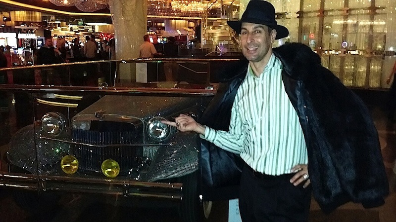 David Bier and a replica of the pave diamond Deusenberg that Liberace drove on stage in 1986 for his final performances at Radio City Music Hall (Las Vegas, 2014)