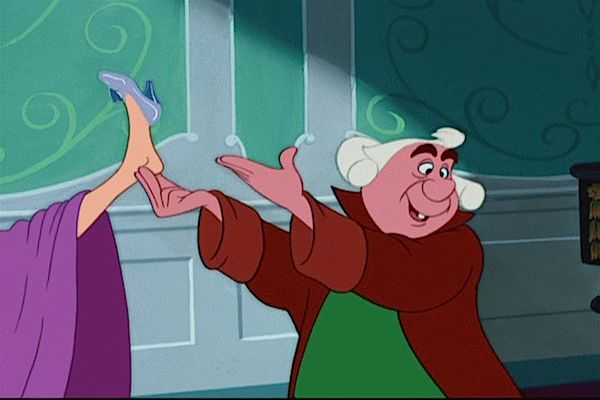 The Ugly Stepsister tries on the glass slipper in Disney's Cinderella from 1950.